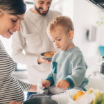 Young family in the kitchen cooking