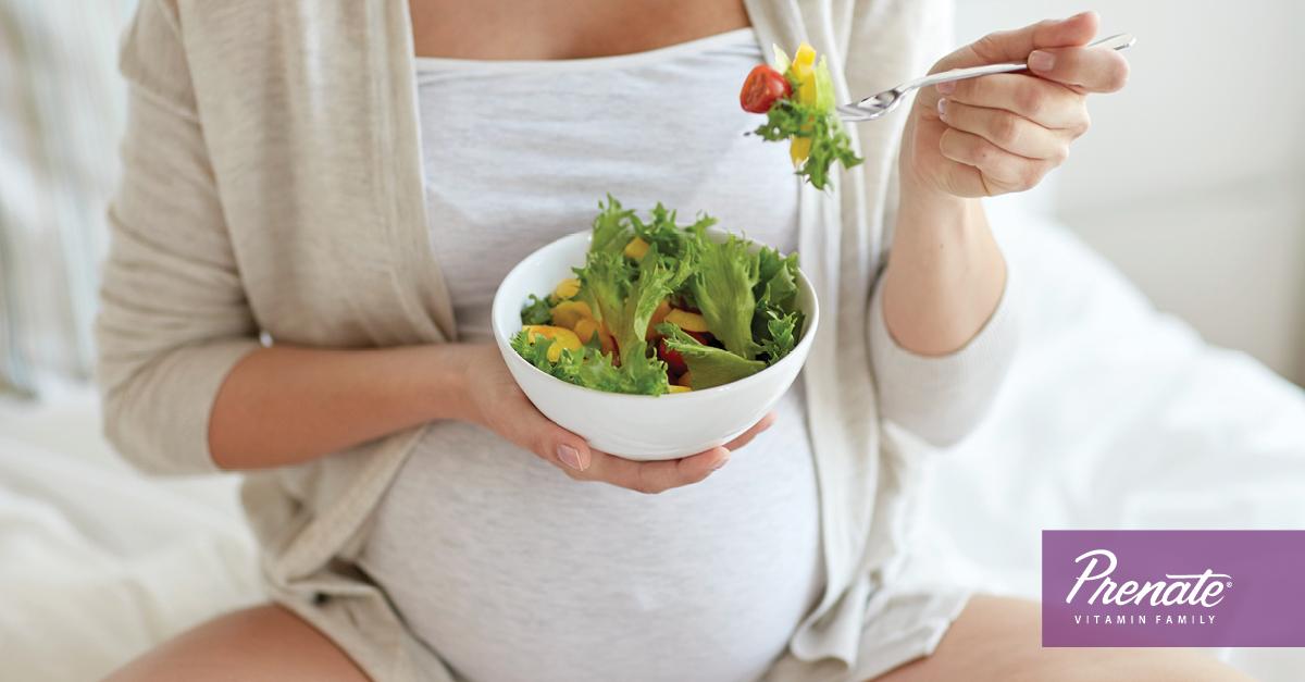 Pregnant woman eating a salad