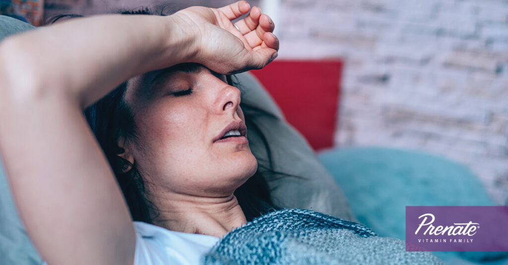 Woman laying in bed ill