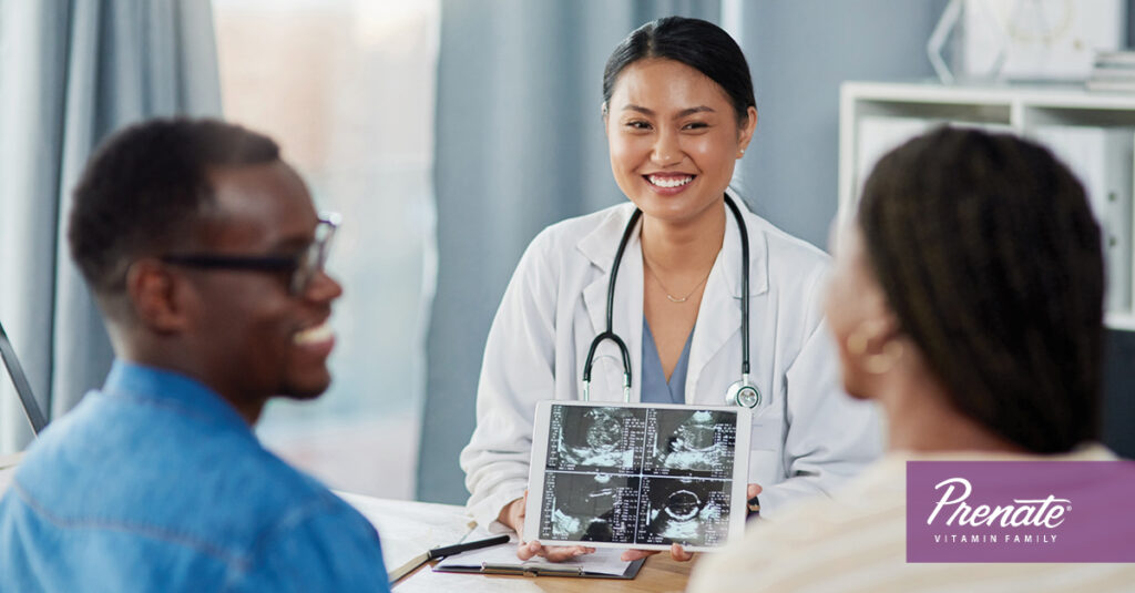 Man and woman consulting with a doctor