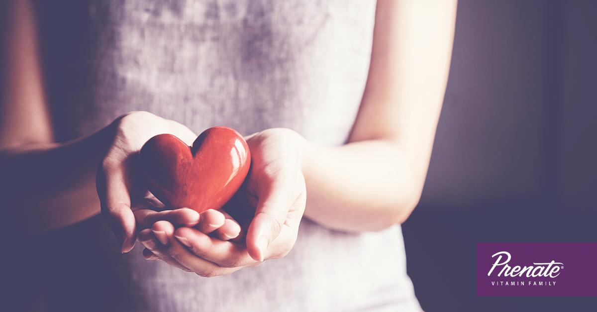 Woman holding plastic heart