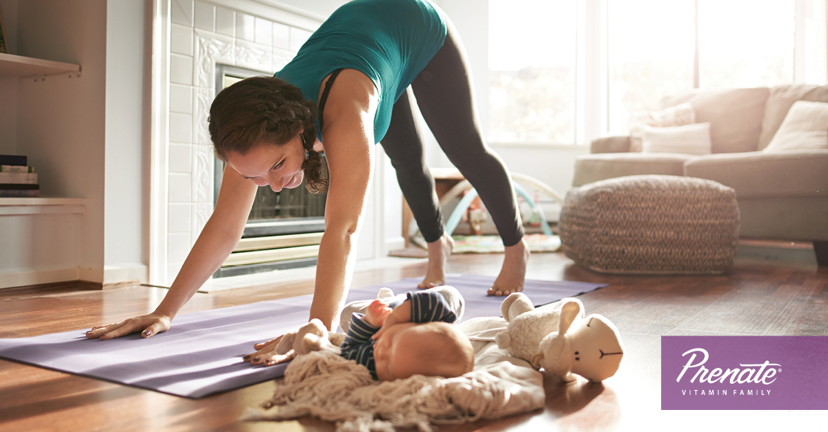 Mother stretching next to baby